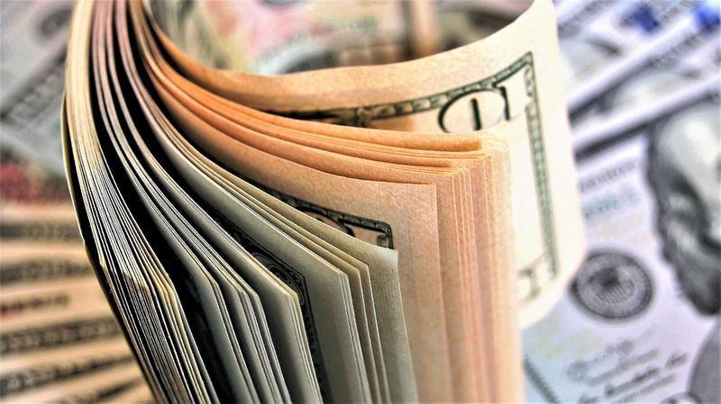 dollar slips to safe haven currencies