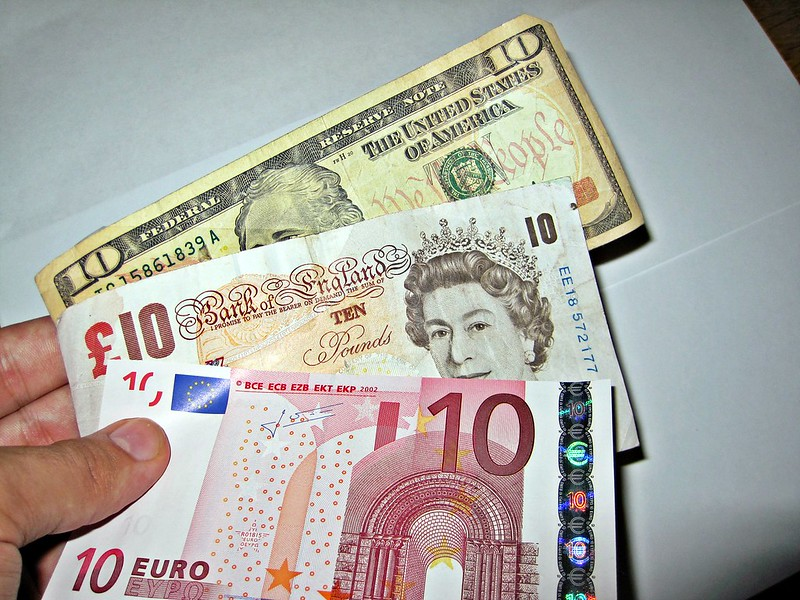 dollar slips to euro and pound