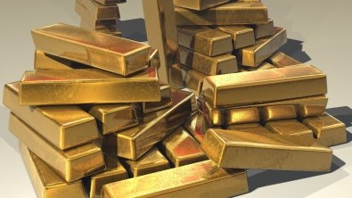 Gold drops as investors turn to risky assets