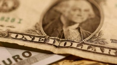 Dollar wobbles after largest weekly increase in a month