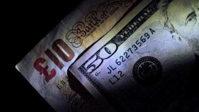 British pound slips on softening service sector report