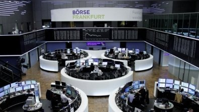 European shares rise modestly on corporate updates