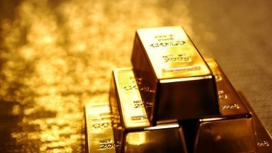 Gold slips, set for narrow decline for the week