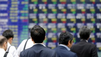 Asian shares post modest losses on concerns about growth