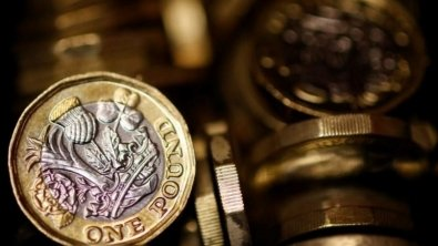 Pound slides from day's top after strong retail sales figures