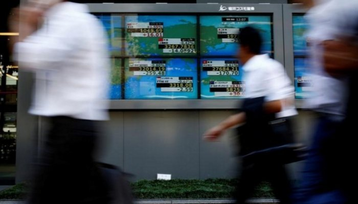 Asian shares slide as U.S. Treasury yields touch above 2.97 percent