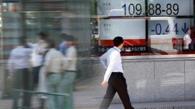Firm dollar beats Asian stocks