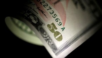 Dollar retreats from 11-month peak; sterling firm after BOE meeting