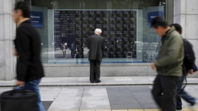 Asian shares dip as weak oil prices weigh