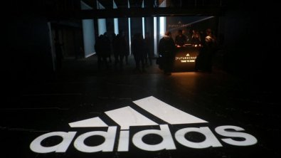 Europe's stock markets mostly up; Adidas AG shares soar
