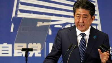 Review: Japan's shares climb on Abe election win