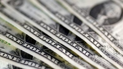 Review: Dollar rises on looming tax reform